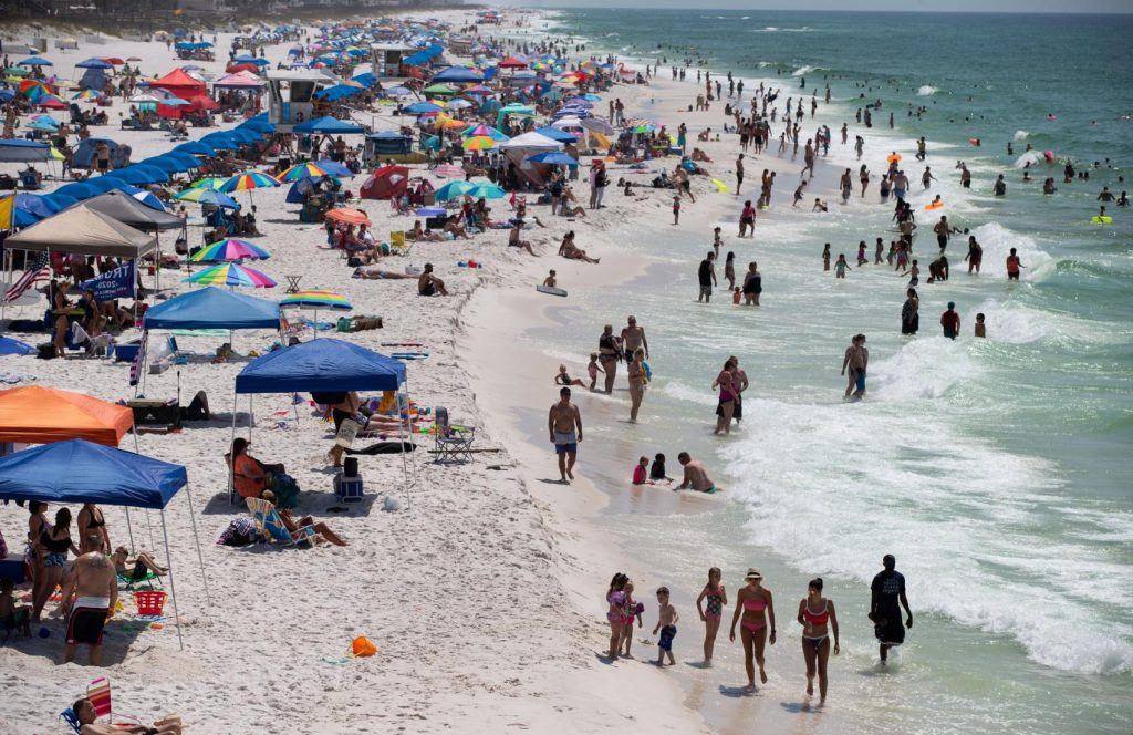 Photos: Big crowds, bright sun, not much social distancing at Gulf Coast beaches on Memorial Day weekend