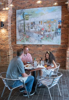 The Wine Bar on Palafox re-opens with ramped up menus, influx of Pensacola-themed art