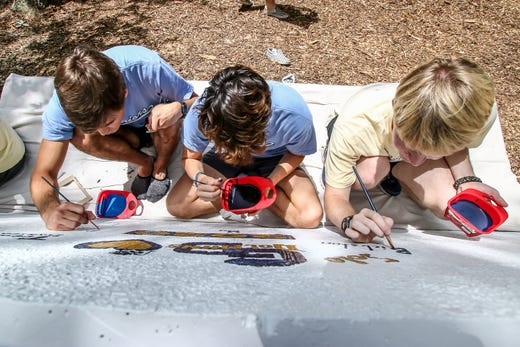 New graduation tradition: Gulf Breeze High seniors paint 7-ton slab of old Pensacola Bay Bridge