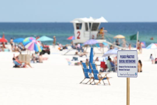 Pensacola area residents return to beach after being denied more than a month